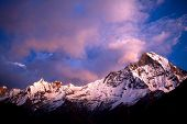 Mount Machapuchare (Fishtail) at sunset - view from Annapurna base camp. Machhapuchchare is a mountain in the Annapurna Himal of north Central Nepal. poster