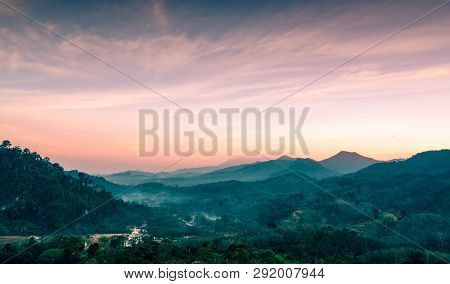 Beautiful Nature Landscape Of Mountain Range With Sunset Sky And Clouds. Rural Village In Mountain V