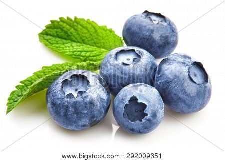 Berry blueberry with leaf mintclose-up. Fruity still life for organic healthy food, isolated on white background. poster