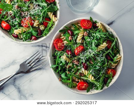 Warm Salad With Tuna, Arugula, Tomatoes, Red Bean, Pasta. Idea And Recipe For Healthy Lunch Or Dinne