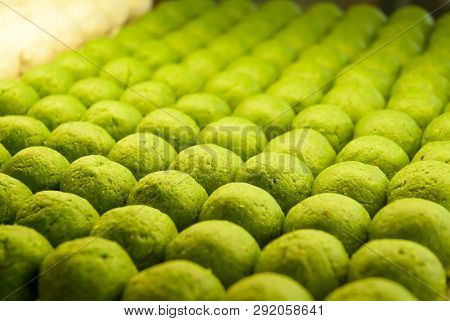 Close Up Of Sweet White Balls With Kiwi Flavour Displayed In Patisserie