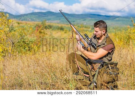 Hunter With Rifle Looking For Animal. Hunting Hobby And Leisure. Man Charging Hunting Rifle. Hunting
