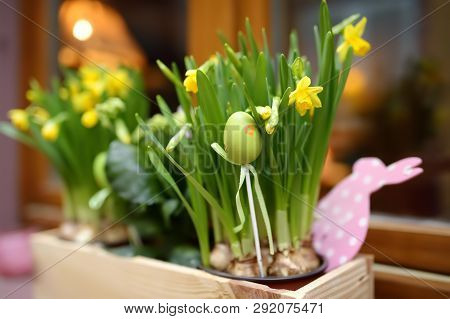 Cozy Window Of A Wooden House Decorated With Flowers And Wooden Ornaments For Easter. Catholic Holid