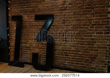 In The Room Near The Vintage Brick Wall There Are Big Black Numerals 13. Original Interior Of The St