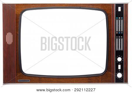 Front panel of vintage veneer decorated CRT television set made in USSR with cut out screen and controls isolated on white background