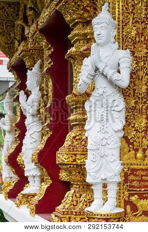 Statue At Wat Buppharam In The Old Town Of Chiang Mai, Thailand