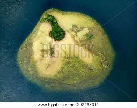Aerial Top Down View Of Small Island. Birds Eye View Of Beautiful Green Waters Of Lake Baltieji Laka