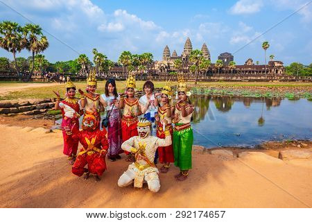 Siem Reap, Cambodia - March 22, 2018: Unidentified Artists Posing In Traditional Khmer Costumes At T