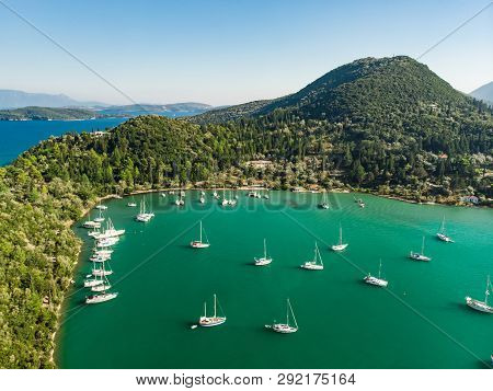 Aerial View Of Nidri Port With Plenty Of Boats And Yachts. Coast Of Lefkada Island On Sunny Summer D