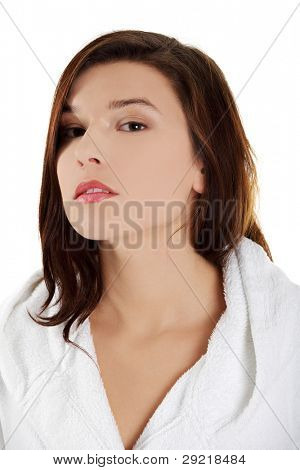 Young beautiful woman in bathrobe, isolated on white