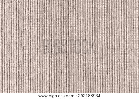 Dense woven ribbed texture. Upholstery fabric close up. Empty light beige background for layouts. poster