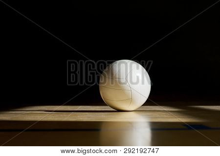 Volleyball Court Wooden Floor With Ball Isolated On Black