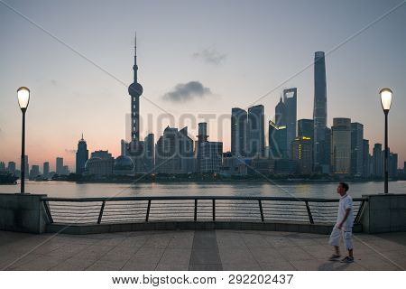 Shanghai, China - 08 27 2016: Chinese People Enjoy Walking Or Running At The Bund Early In The Morni