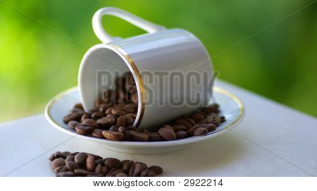 Cup Overthrown With Coffee Grains.