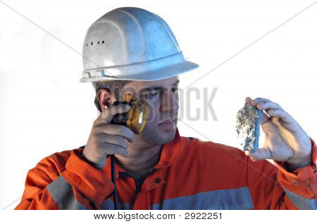 Mine Worker With Rock
