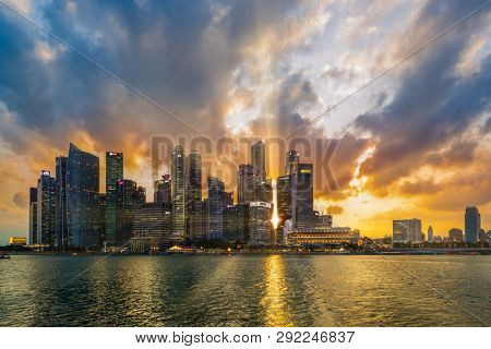 Singapore, Singapore - MARCH 4, 2019: View at Singapore City Skyline, which is the iconic landmarks of Singapore at sunset