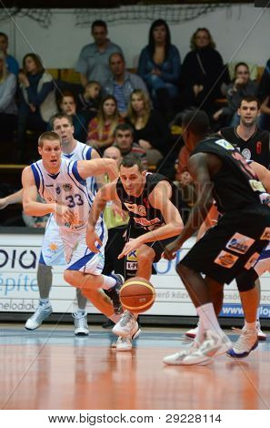 KAPOSVAR, HUNGARY - JANUARY 21: Nik Raivio (white 33) in action at a Hungarian National Championship basketball game with Kaposvar (white) vs. Szolnok (black) on January 21, 2012 in Kaposvar, Hungary.