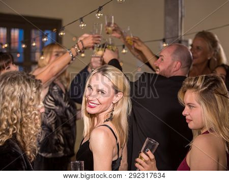 Pointing Mature Woman At A Party Or Reception Being Silly