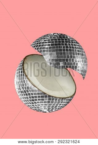 A Paradox. An Alternative Coconut Or Musicial Nut As A Silver Bright Discoball Against Trendy Light