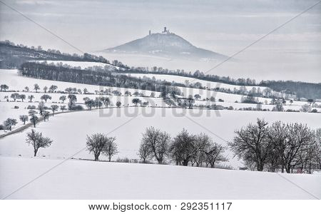 Winter Fields With Castle On The Foggy Hill