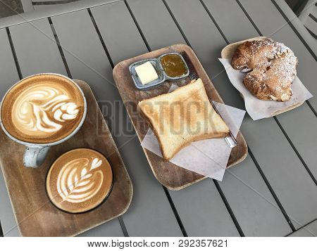 Breakfast Items On A Wooden Serving Plate At A Restaurant Bakery Cafe.