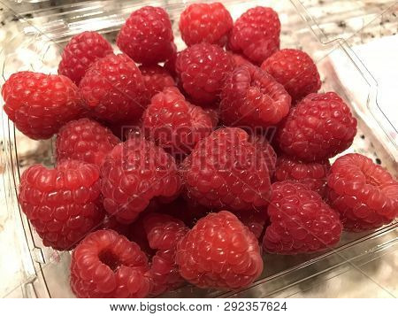 Fresh Raspberries Bought From The Local Grocery Store.