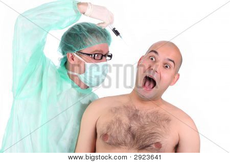 Surgeon Injecting A Scare Patient