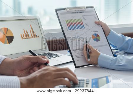 Businessmen Are Analyzing Data From Business Report And Marketing Team Brainstorming Process To Data