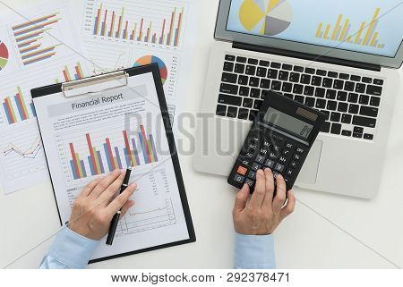 Financial Analyst Reviewing Data In Financial Statement. Accounting , Accountancy Concept. Top View.