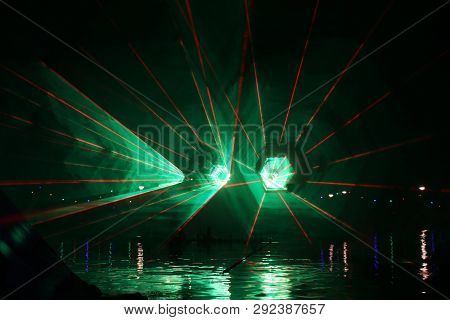 Laser Beams During A Public Show In Several Colors At The Water Of The Ringvaart (ring Canal) Zuidpl