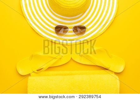 Summer Time Main Objects. Yellow Summer Accessories On The Yellow Background. Summer Beach Accessori