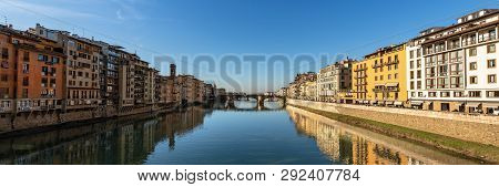 Arno River and the Ponte Santa Trinita, bridge (XVI century) view from the Ponte Vecchio in the downtown of Florence UNESCO world heritage site. Tuscany, Italy, Europe poster
