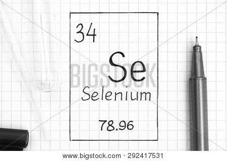 The Periodic table of elements. Handwriting chemical element Selenium Se with black pen, test tube and pipette. Close-up. poster