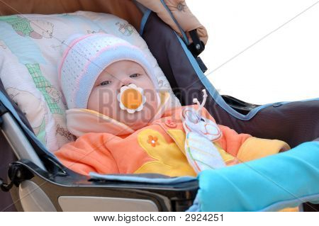 Little Girl With Baby'S Dummy Sit In Carriage.