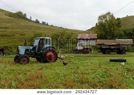 Altai Region, Russia - September 4, 2018: Old Tractor Mtz-80 In The Farmstead Of The Village Of Gene
