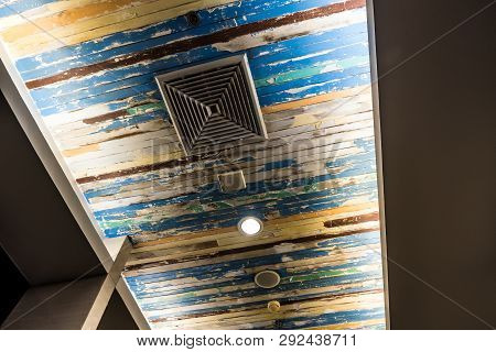 Air Conditioner Mask, Lighting And Modern Equipment On The Ceiling That Decorated With Old Wooden Pa