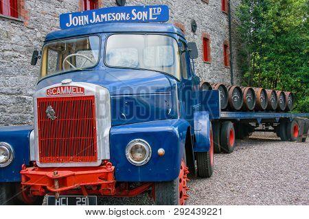 Cork, Ireland - June 20, 2008:  Loading Wooden Barrels On Old Open Truck Trailer In Museum Of Irish