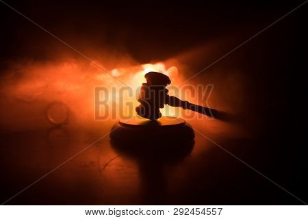 Document With Judge On Wooden Table. Law Theme. Selective Focus