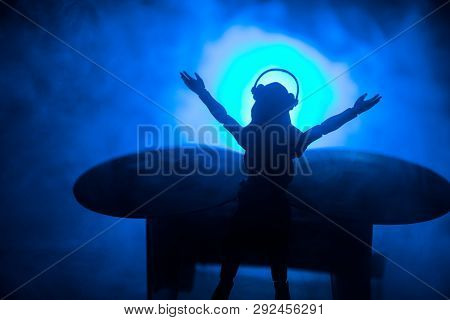 Dj Club Concept. Woman Dj Mixing, And Scratching In A Night Club. Girl Silhouette On Dj's Deck, Stro