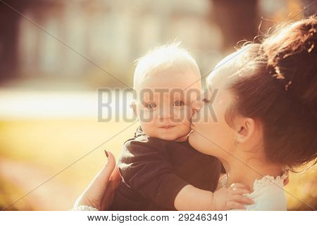 Woman Kiss Child With Love. Mother And Little Son. Mom And Baby Boy Outdoor. Mothers Day Concept. Ha