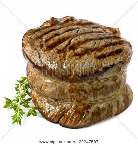 Filet mignon, chargrilled to perfection.  Isolated on white.
