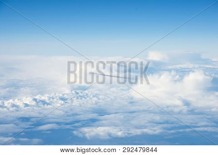 Airplane And Its Dark Track Above Clouds