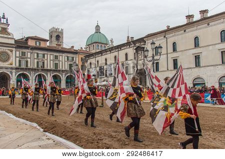 Italy, Brescia - October 01 2017: The View Of The Flag Bearers At Traditional Parade, Celebrations O