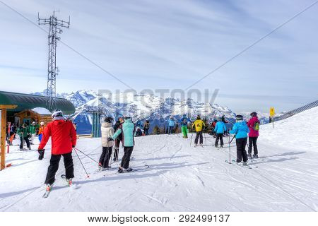 Lake Louise, Canada - Mar 23, 2019: Skiers At Top Of The Canadian Rockies At Lake Louise With Mount