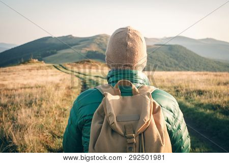 Man with backpack on mountains road. Travel concept. Landscape photography