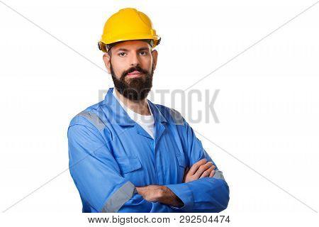 Builder In Hard Hat, Foreman Or Repairman In The Helmet. Bearded Man Worker With Beard In Building H
