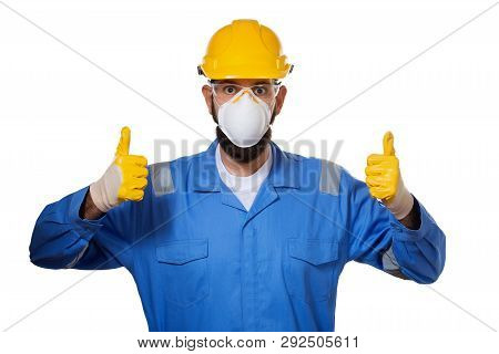 Builder In Hard Hat In Mask And Transparent Safety Glasses Raising His Thumbs Up In Working Gloves,
