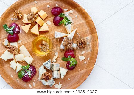 Cheese Plate. Banquet, Restaurant Menu. Slices Of Various Cheeses. Camembert, Parmesan, Dorblu  And
