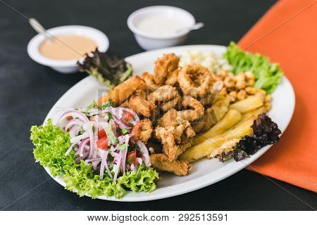 Chicharrón With French Fries, Peruvian Sauce And Garlic Sauce