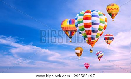 Colorful Hot Air Balloon Fly Over Blue Sky And White Cloud With Copy Space